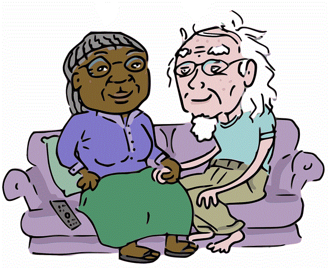 Older couple sitting on couch.